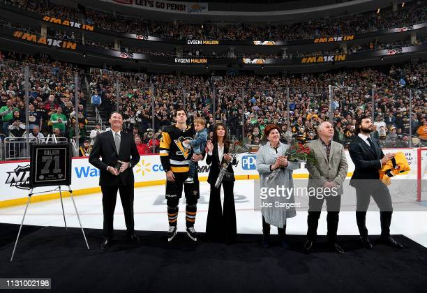 Evgeni Malkin of the Pittsburgh Penguins is honored for his 1000 NHL points before the game against the St Louis Blues at PPG Paints Arena on March...