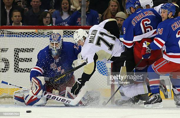 Evgeni Malkin of the Pittsburgh Penguins is tripped up in front of Henrik Lundqvist of the New York Rangers at Madison Square Garden on April 3 2013...