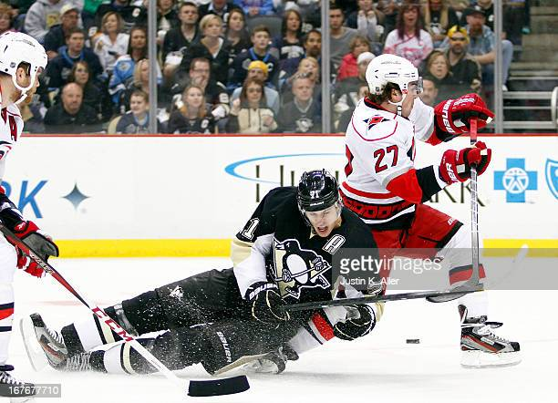 Evgeni Malkin of the Pittsburgh Penguins is upended by Justin Faulk of the Carolina Hurricanes during the game at Consol Energy Center on April 27...