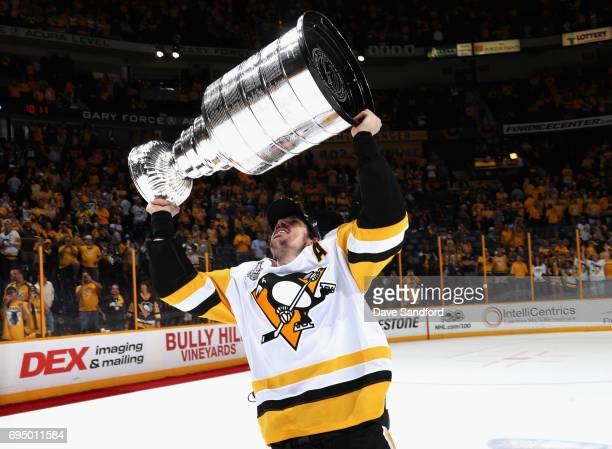 Evgeni Malkin of the Pittsburgh Penguins lifts the Stanley Cup after the Penguins defeated the Nashville Predators 20 to win the 2017 NHL Stanley Cup...