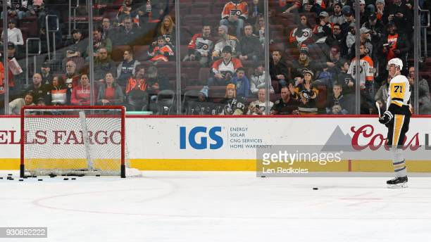 Evgeni Malkin of the Pittsburgh Penguins looks on during warmups against the Philadelphia Flyers on March 7 2018 at the Wells Fargo Center in...
