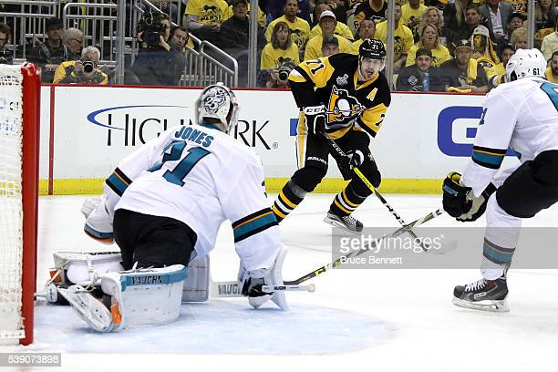Evgeni Malkin of the Pittsburgh Penguins looks to take a shot on Martin Jones of the San Jose Sharks during the first period in Game Five of the 2016...