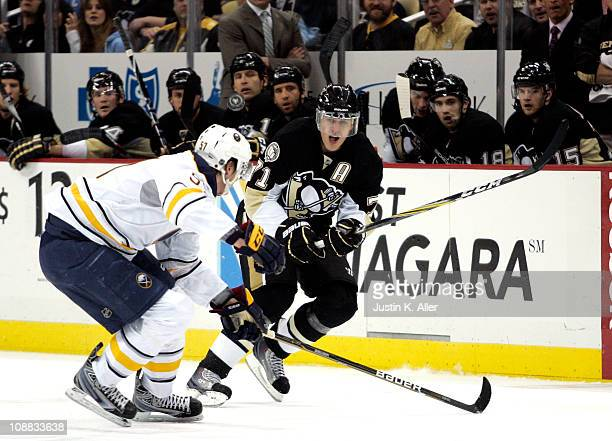 Evgeni Malkin of the Pittsburgh Penguins makes a pass against the Buffalo Sabres at the Consol Energy Center on February 4 2011 in Pittsburgh...