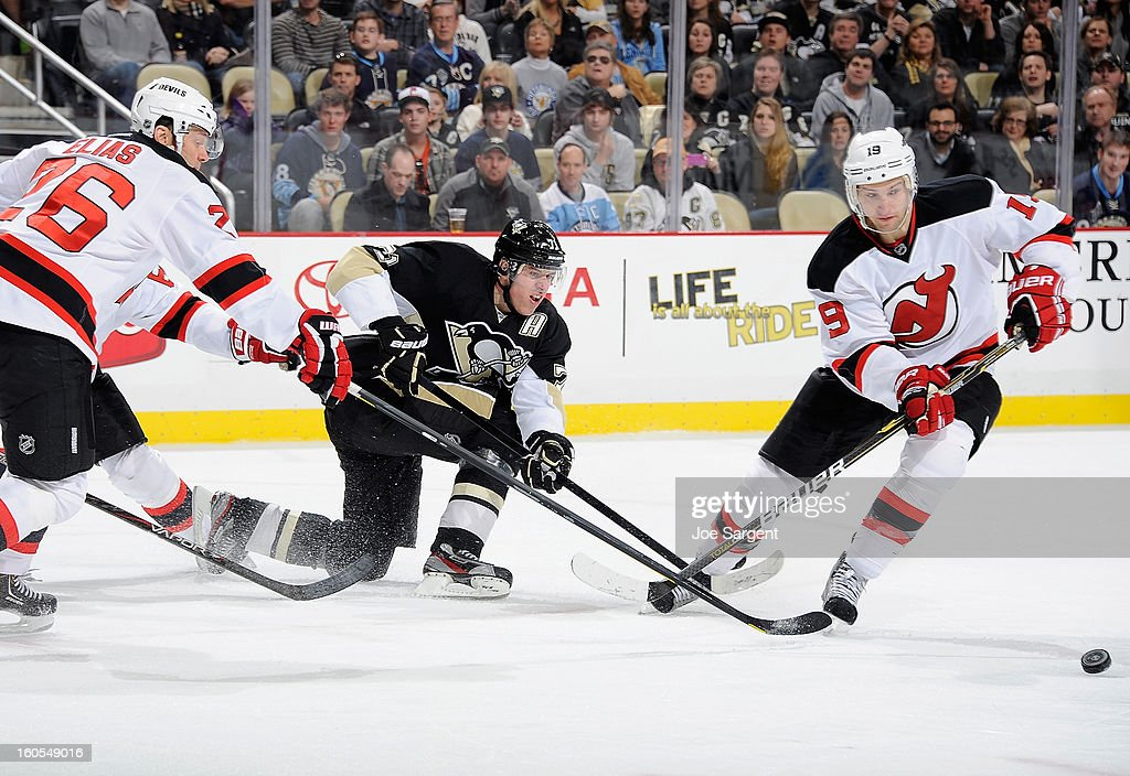 Evgeni Malkin #71 of the Pittsburgh Penguins makes a pass between the defense of Patrik Elias #26 and Travis Zajac #19 of the New Jersey Devils on February 2, 2013 at Consol Energy Center in Pittsburgh, Pennsylvania.