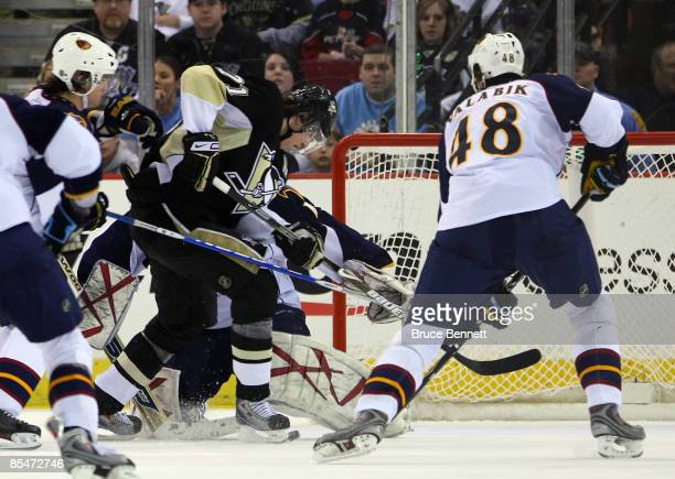 Evgeni Malkin of the Pittsburgh Penguins moves past the Atlanta Thrashers defense to score his first of two second period goals at the Mellon Arena...