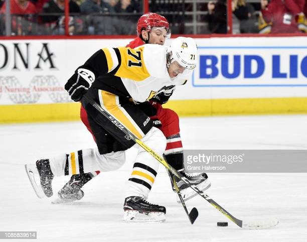 Evgeni Malkin of the Pittsburgh Penguins moves the puck up the ice against the Carolina Hurricanes in the second period of their game at PNC Arena on...