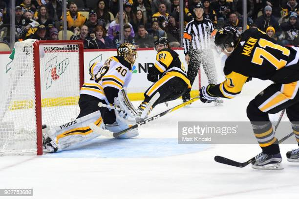 Evgeni Malkin of the Pittsburgh Penguins puts the game winning goal in overtime past Tukka Rask of the Boston Bruins at PPG PAINTS Arena on January 7...
