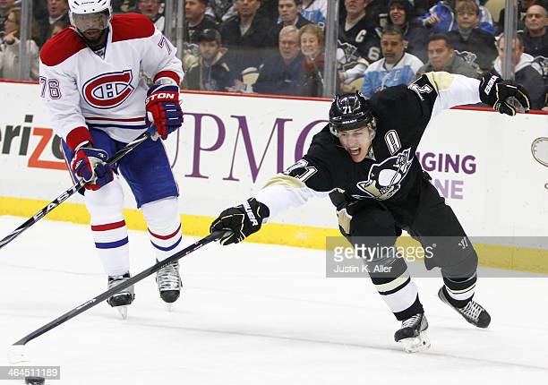 Evgeni Malkin of the Pittsburgh Penguins reaches for a puck against the Montreal Canadiens during the game at Consol Energy Center on January 22 2014...