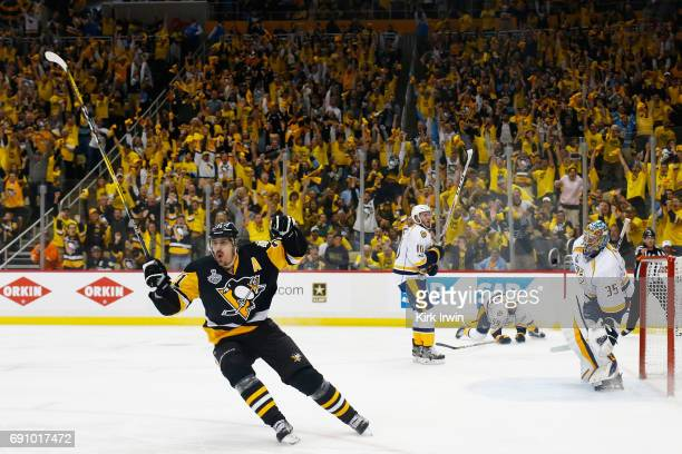 Evgeni Malkin of the Pittsburgh Penguins reacts after scoring a goal during the third period in Game Two of the 2017 NHL Stanley Cup Final against...