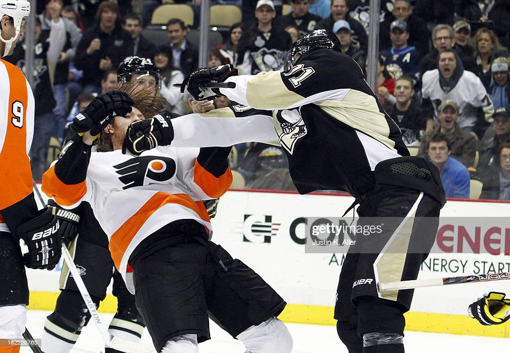 Evgeni Malkin #71 of the Pittsburgh Penguins roughs up Sean Couturier #14 of the Philadelphia Flyers during the game at Consol Energy Center on February 20, 2013 in Pittsburgh, Pennsylvania. The Flyers defeated the Penguins 6-5.