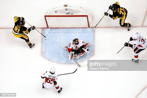 Evgeni Malkin of the Pittsburgh Penguins scores a goal against Craig Anderson of the Ottawa Senators during the third period in Game One of the...