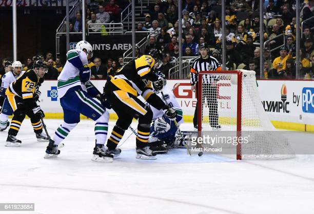 Evgeni Malkin of the Pittsburgh Penguins scores a goal against the Vancouver Canucks at PPG PAINTS Arena on February 14 2017 in Pittsburgh...