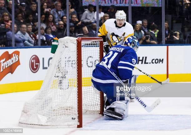 Evgeni Malkin of the Pittsburgh Penguins scores against Frederik Andersen of the Toronto Maple Leafs during the first period at the Scotiabank Arena...