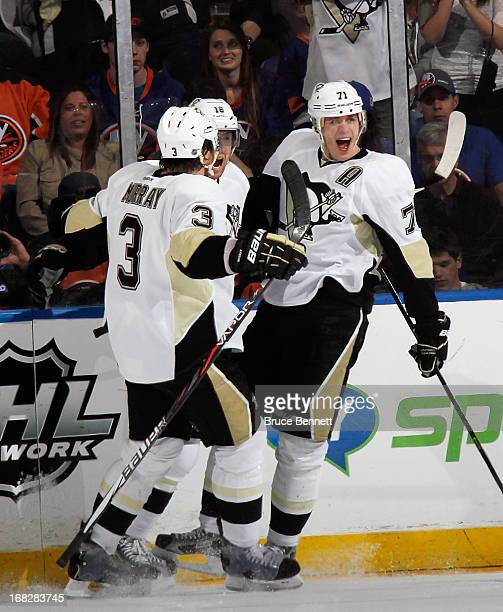 Evgeni Malkin of the Pittsburgh Penguins scores at 717 of the second period against the New York Islanders and is joined by Douglas Murray and James...