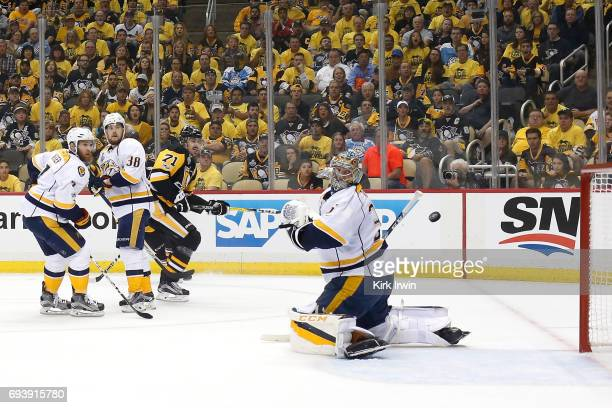 Evgeni Malkin of the Pittsburgh Penguins scores is team's third goal of the first period against Yannick Weber Viktor Arvidsson and goalie Pekka...