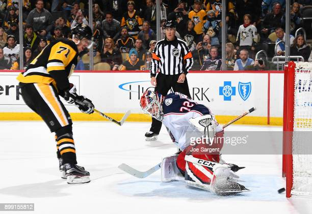 Evgeni Malkin of the Pittsburgh Penguins scores on his shootout attempt past Sergei Bobrovsky of the Columbus Blue Jackets at PPG Paints Arena on...
