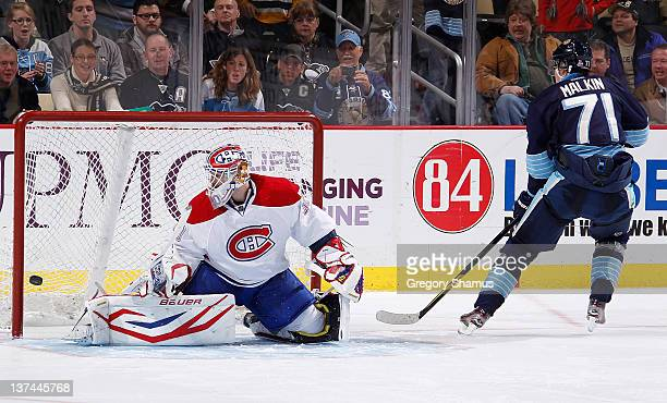 Evgeni Malkin of the Pittsburgh Penguins scores on his shootout attempt against Peter Budaj of the Montreal Canadiens on January 20 2012 at Consol...