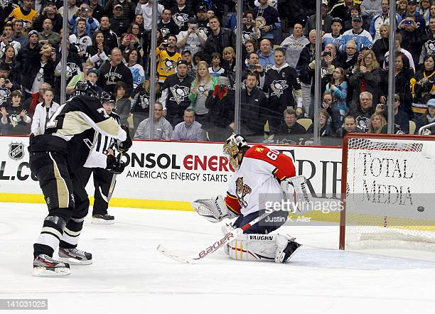 Evgeni Malkin of the Pittsburgh Penguins scores on Jose Theodore of the Florida Panthers during the shootout during the game at Consol Energy Center...