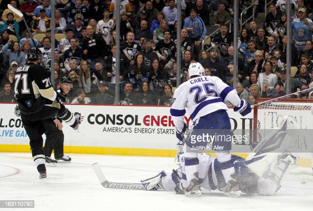 Evgeni Malkin of the Pittsburgh Penguins scores past Anders Lindback of the Tampa Bay Lightning during the game at Consol Energy Center on March 4...