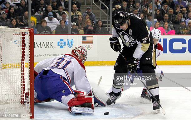 Evgeni Malkin of the Pittsburgh Penguins scores past Carey Price of the Montreal Canadiens in the second period during the game at Consol Energy...