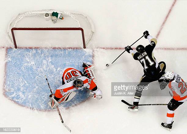 Evgeni Malkin of the Pittsburgh Penguins scores past Ilya Bryzgalov of the Philadelphia Flyers during the game at Consol Energy Center on February 20...