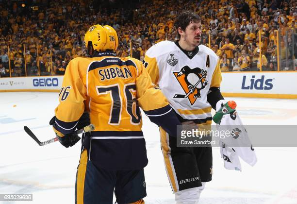 Evgeni Malkin of the Pittsburgh Penguins shakes hands with PK Subban of the Nashville Predators after the Penguins defeated the Nashville Predators...