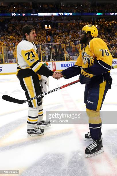 Evgeni Malkin of the Pittsburgh Penguins shakes hands with PK Subban of the Nashville Predators after winning Game Six of the 2017 NHL Stanley Cup...