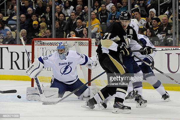 Evgeni Malkin of the Pittsburgh Penguins shots a puck on Evgeni Nabokov of the Tampa Bay Lightning in the third period at Consol Energy Center on...