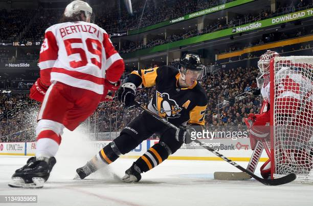 Evgeni Malkin of the Pittsburgh Penguins skates against Jimmy Howard of the Detroit Red Wings at PPG Paints Arena on April 4 2019 in Pittsburgh...
