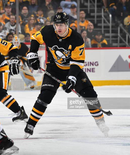 Evgeni Malkin of the Pittsburgh Penguins skates against the Boston Bruins at PPG Paints Arena on March 10 2019 in Pittsburgh Pennsylvania