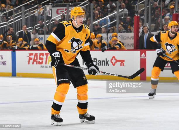 Evgeni Malkin of the Pittsburgh Penguins skates against the Columbus Blue Jackets at PPG Paints Arena on March 7 2019 in Pittsburgh Pennsylvania