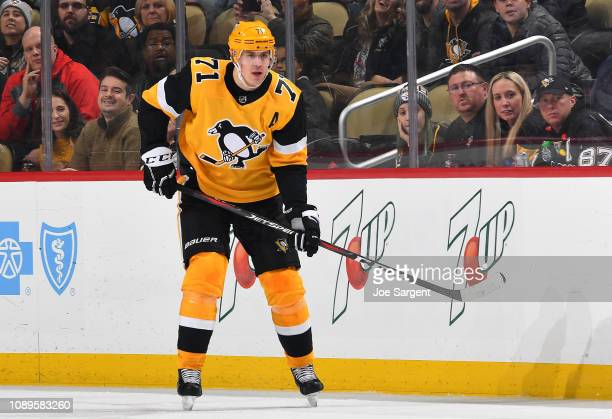 Evgeni Malkin of the Pittsburgh Penguins skates against the Detroit Red Wings at PPG Paints Arena on December 27 2018 in Pittsburgh Pennsylvania