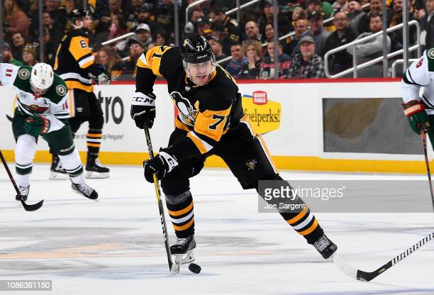 Evgeni Malkin of the Pittsburgh Penguins skates against the Minnesota Wild at PPG Paints Arena on December 20 2018 in Pittsburgh Pennsylvania