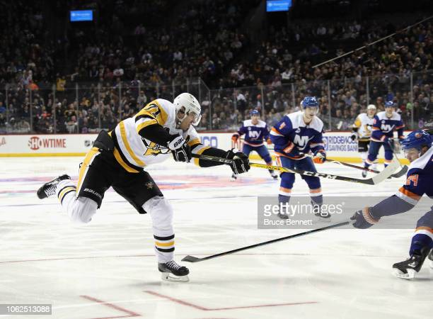 Evgeni Malkin of the Pittsburgh Penguins skates against the New York Islanders at the Barclays Center on November 01, 2018 in the Brooklyn borough of...