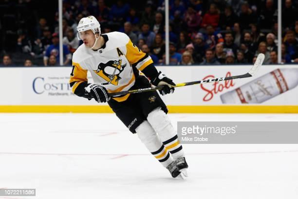 Evgeni Malkin of the Pittsburgh Penguins skates against the New York Islanders at Nassau Veterans Memorial Coliseum on December 10, 2018 in...