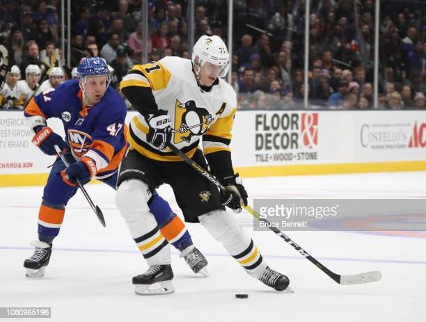 Evgeni Malkin of the Pittsburgh Penguins skates against the New York Islanders at NYCB Live at the Nassau Coliseum on December 10, 2018 in Uniondale,...