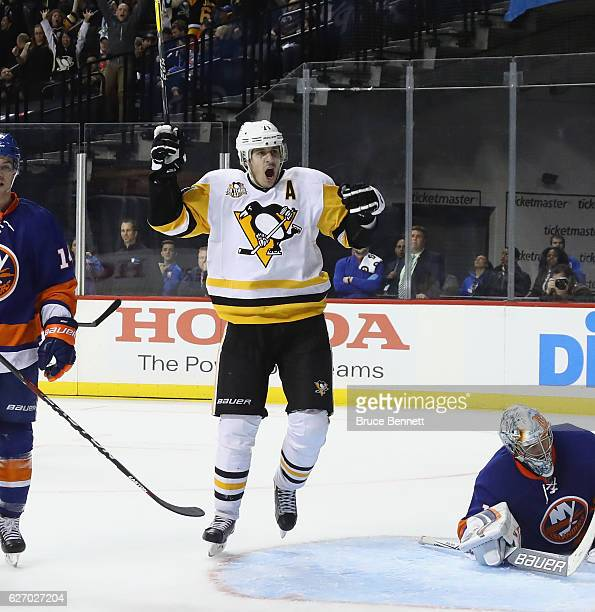Evgeni Malkin of the Pittsburgh Penguins skates against the New York Islanders at the Barclays Center on November 30 2016 in the Brooklyn borough of...