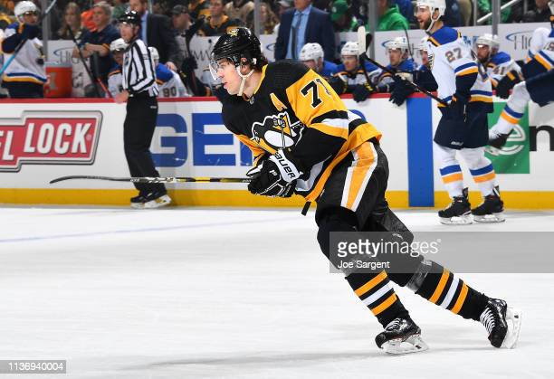 Evgeni Malkin of the Pittsburgh Penguins skates against the St Louis Blues at PPG Paints Arena on March 16 2019 in Pittsburgh Pennsylvania