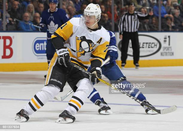 Evgeni Malkin of the Pittsburgh Penguins skates against the Toronto Maple Leafs during an NHL game at the Air Canada Centre on March 10 2018 in...