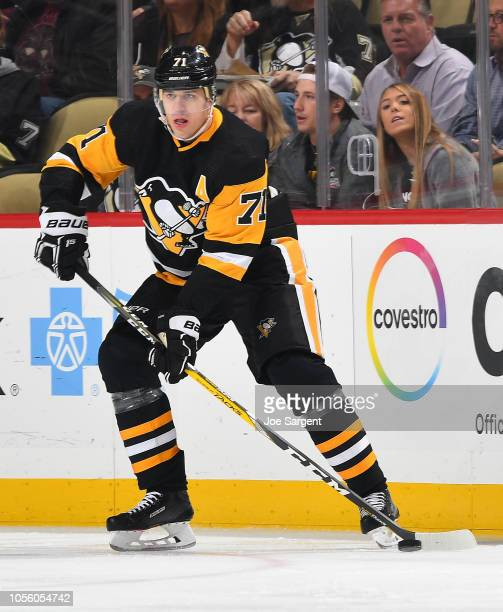 Evgeni Malkin of the Pittsburgh Penguins skates against the Vancouver Canucks at PPG Paints Arena on October 16 2018 in Pittsburgh Pennsylvania