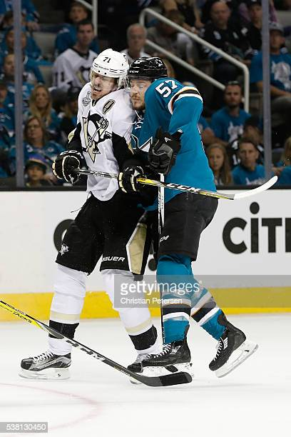 Evgeni Malkin of the Pittsburgh Penguins skates against Tommy Wingels of the San Jose Sharks during the second period in Game Three of the 2016 NHL...