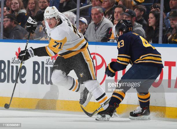 Evgeni Malkin of the Pittsburgh Penguins skates away from Conor Sheary of the Buffalo Sabres during an NHL game on March 14 2019 at KeyBank Center in...