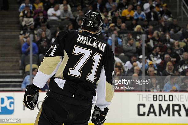 Evgeni Malkin of the Pittsburgh Penguins skates before a faceoff against the Tampa Bay Lightning at Consol Energy Center on December 15 2014 in...