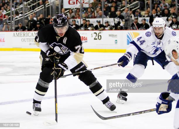 Evgeni Malkin of the Pittsburgh Penguins skates in front of Nate Thompson of the Tampa Bay Lightning during the game at Consol Energy Center on March...