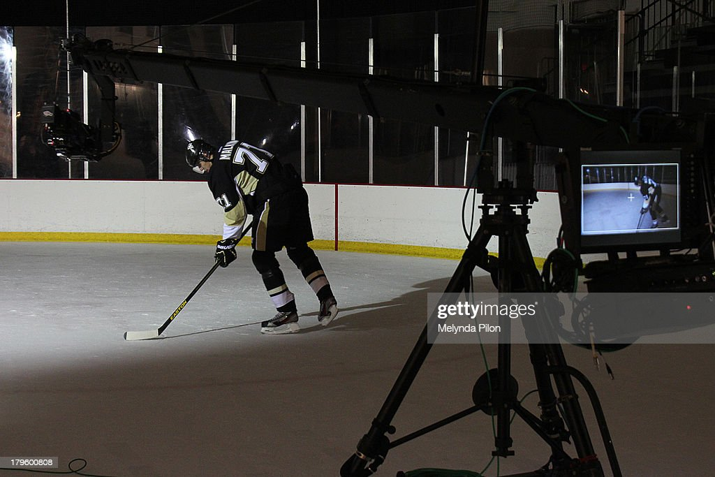 Evgeni Malkin of the Pittsburgh Penguins skates on the ice during a production shoot at the 2013 NHL Player Media Tour at the Prudential Center on September 5, 2013 in Newark, New Jersey.