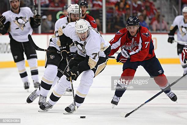 Evgeni Malkin of the Pittsburgh Penguins skates past TJ Oshie of the Washington Capitals during the second period in Game Five of the Eastern...
