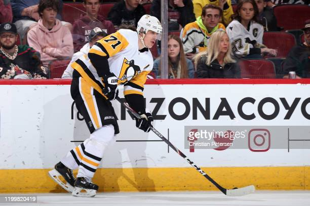 Evgeni Malkin of the Pittsburgh Penguins skates with the puck against the Arizona Coyotes during the NHL game at Gila River Arena on January 12, 2020...