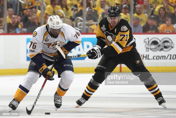 Evgeni Malkin of the Pittsburgh Penguins slashes PK Subban of the Nashville Predators for a penalty during the third period of Game One of the 2017...