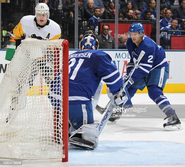 Evgeni Malkin of the Pittsburgh Penguins slides a puck past Frederik Andersen of the Toronto Maple Leafs during an NHL game at Scotiabank Arena on...