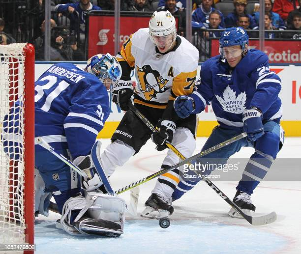 Evgeni Malkin of the Pittsburgh Penguins squeezes between Frederik Andersen and Nikita Zaitsev of the Toronto Maple Leafs during an NHL game at...